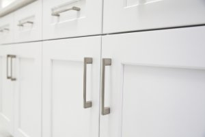 New white kitchen cabinets with silver knobs
