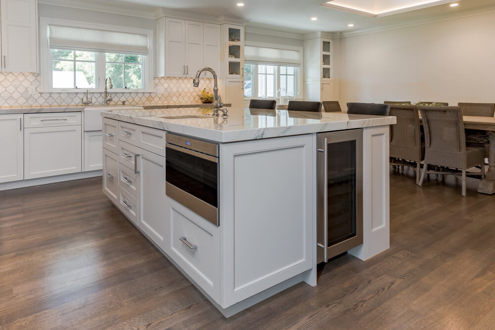 New kitchen island in a bright white kitchen