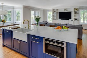 A bright kitchen island that looks out over the living room